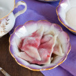 Stock Photo: Dumplings with a cherry on test with rice flour