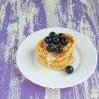 Pancakes with black currant — Stock Photo #27429283