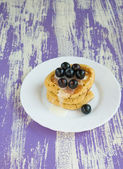 Pancakes with black currant — Stock Photo