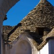 View of trullo through an arch - Stock Photo
