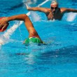 Stock Photo: Swimmers training in pool