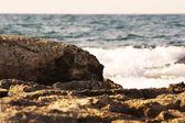 Rock on italian beach — Stock Photo