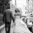 Married couple walking on street - Stock Photo