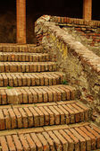 Old brick stairs and columns — Stock Photo