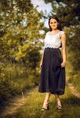 Girl in long skirt — Stock Photo