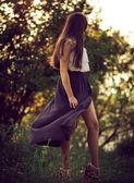 Girl swirling her skirt — Stock Photo