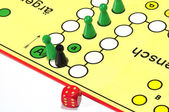 A board game. The black figure kick the green figure curtly to the goal out — Stock Photo