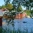 Red painted boathouse — Stock Photo
