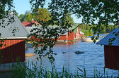 Red painted boathouse — Foto Stock