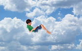 The child is reading a book on the cloud — Stock Photo