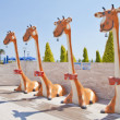 Sweet Giraffe Shower in Toys City — Stock Photo