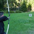 Archer aiming at the target - Stock Photo