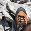 Hiking boot on stone - Stock Photo