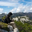 Mountaineer resting on top of hill — Stock Photo #14793355