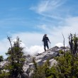 The mountaineer on the top of the hill - Stock Photo