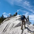 Stock Photo: Two mountaineers hiking to the top of the mountain
