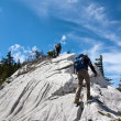 Two mountaineers hiking to the top of the mountain — Stock Photo