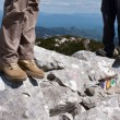 Two mountaineers standing on the top of the hill — Stock Photo