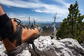 Hiking boot on stone — Stock Photo