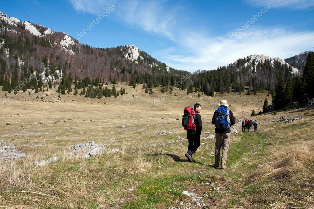 Two mountaineers go hiking on the mountains  Stock Photo #14795053