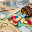 Pills and Australian dollars — Stock Photo
