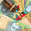 Pills and Australidollars — Stock Photo #16794401