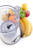 Electrical blender whit fruits — Stock Photo