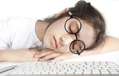 Little girl asleep in front of the computer — Stock Photo