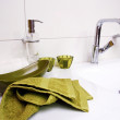 Clebathroom sink with green towel — Stockfoto #15786549