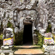 Cave entrance in the shape of open mouth on bali — Stock Photo