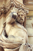 Gothic statue of muscular man — Stock Photo