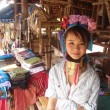 CHIANG MAI, THAILAND - JUNE 2012: Unidentified girl from long neck Karen tribe sells souvenirs on June 2012 in Chiang Mai. Many Karen tribes fled to Thailand due to conflict with the regime in Burma. — Foto de Stock