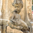 Stock Photo: Boy statue fountain