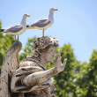 Birds sitting on angel statue — Stock Photo #28820305