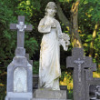 Woman statue on cemetery — Stock Photo