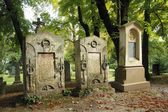 Ancient graveyard tomb stones — Stock Photo