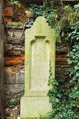 Worn tombstone — Stock Photo