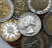 Quarter dollar in pile of coins — Stock Photo