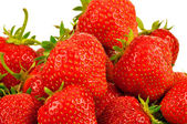 Lots of fresh strawberries on white background — Stock Photo