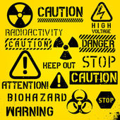 Set Of Warning Hazard Symbols And Text — Stockvektor