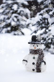 Toy snowman in a hat on snow — Stock Photo