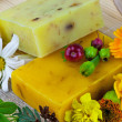 Composition from natural soap and flowers — Stock Photo