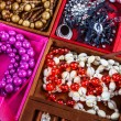 Boxes of different colors with jewelry — Stock Photo