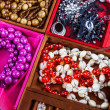 Boxes of different colors with jewelry - Stock Photo