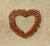 Heart shape from almonds — Stock Photo