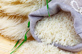 Sack of white rice and rice vermicelli — Stock Photo