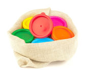 Color paint in flax sack — Stock Photo