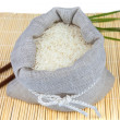 Sack of white rice on the mat — Stock Photo
