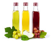 Glass bottles of vinegar — Stock Photo