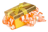 Golden box with bow and pink ribbons — Stock Photo